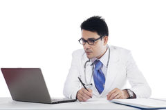 Asian doctor writing prescription Royalty Free Stock Photos