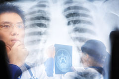 Asian doctors busy working Stock Images