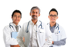 Asian doctors. Multiracial doctors / diverse medical team standing isolated on white background Stock Photos