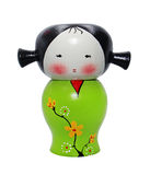 Asian doll wooden statue isolated. On white Royalty Free Stock Image