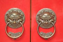 Asian Door Handles. Chinese Door way with Handles and Gargoyles stock image