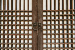 Asian doors and doorknob. In Ancient palace in Seoul, Korea Royalty Free Stock Images