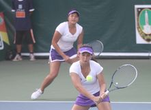 Asian double tennis. Indonesia top double tennis player, Beatrice Gumulya (left) and Jessy Rompies, try to hit the ball when competing in international tennis stock photography