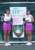 Asian double tennis Stock Images