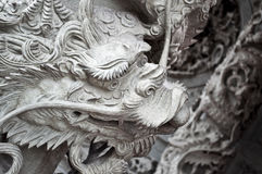 Asian dragon. Statue of oriental style dragon holding a ball in its mouth Stock Photos