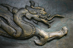 Asian dragon in bronze Stock Image