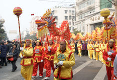 ASIAN   DRAGON DANCE. Chinese men and women get together to play dragon dance to expect good weather and good harvests during the   lantern festival ,February Royalty Free Stock Images