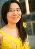 asian dress girl pretty smiling yellow Στοκ φωτογραφία με δικαίωμα ελεύθερης χρήσης