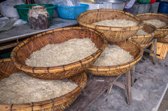 Asian dried gelatin noodles food in wooden baskets. On wooden bench in a rural kitchen Royalty Free Stock Images