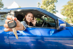 Asian driver woman smiling showing car keys Royalty Free Stock Images