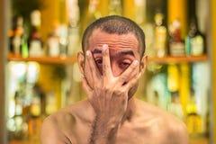 Asian drunk man against blur alcohol shelf background Stock Image