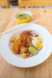Asian dry noodle with garnish on the wooden background Royalty Free Stock Photos