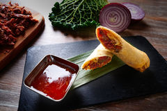Asian Duck rolls with sweet and sour sauce Royalty Free Stock Photography