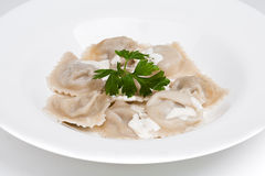 The asian dumplings with sauces. On the plate Royalty Free Stock Photo