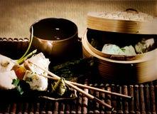 Asian dumplings with tea Stock Photos