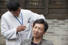 Asian ear picker Stock Photos