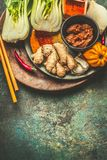 Asian eating and cooking with healthy ingredients: ginger, chili and spices on vintage background, top view. Place for text royalty free stock photo
