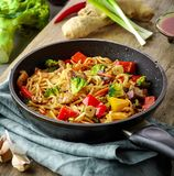 Asian egg noodles with vegetables and meat Stock Image