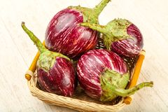Asian eggplant. Heap over the wooden background stock photography