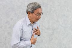 Asian Elder suffer from Chest pain from Heart Attack. Or Stroke stock image