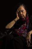 Asian elder woman feeling headache Stock Photo