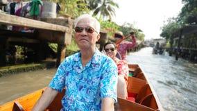 Asian elderly couple having fun retirment trip around the world Royalty Free Stock Photos