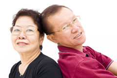 Asian elderly couple portrait. Portrait of an elderly asian couple posing back to back Royalty Free Stock Photography