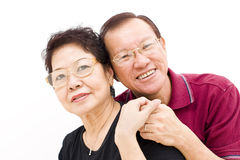 Asian elderly couple portrait. Portrait of an elderly asian couple posing back to back Royalty Free Stock Photo