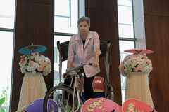 asian elderly senior elder woman riding on tricylcle stock photo