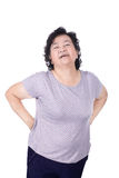 Asian elderly woman with a sick back, backache, isolated on a wh Stock Images
