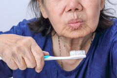 Asian elderly woman with a toothbrush. Dental health stock images