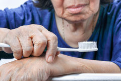 Asian elderly woman with a toothbrush royalty free stock photos