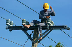 Asian Electrician Climb High, Work On Electric Pole Royalty Free Stock Image