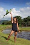 Asian emo dancer waving leaf Royalty Free Stock Image