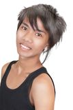 Asian emo teenager portrait. Closeup glamor portrait of emo or punk male Asian teenager, vividly smiling in tank-top and looking into the lens. Isolated over Stock Photos