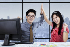 Asian employees celebrating their victory Stock Photos