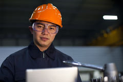 Asian engineer. Portrait asian engineer with laptop look on you camera Stock Photo