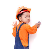 Asian Engineer baby with eraser brush in hand Royalty Free Stock Photos