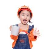 Asian Engineer baby girl holding the white mug. On white background Stock Image