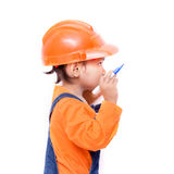 Asian Engineer baby girl with pen in hand Royalty Free Stock Image