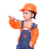 Asian Engineer baby girl and wrench in hand Stock Photo