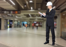 Asian Engineer checking list form of construction for safety Stock Images