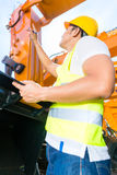 Asian engineer controlling shovel excavator Royalty Free Stock Images