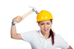 Asian engineer girl hit a hammer on her hardhat Stock Photography