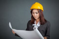 Asian engineer girl hold a blueprint Stock Photography