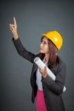 Asian engineer girl hold a blueprint and point up Stock Photos