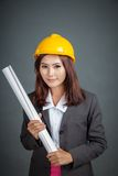 Asian engineer girl hold a blueprint and smile Royalty Free Stock Photos