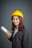 Asian engineer girl hold a blueprint and smile Stock Image