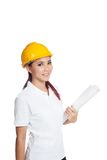 Asian engineer girl hold a blueprint and smile Royalty Free Stock Photo