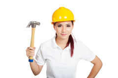 Asian engineer girl hold hammer and smile Stock Photo